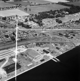 Dundee, general view, showing former Seaplane Base, Stannergate Road and Craigie Drive.  Oblique aerial photograph taken facing north.  This image has been produced from a crop marked negative.