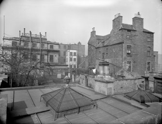 East elevation, showing part of calton Hill Burial Ground and old Tenement at 15 Calton Hill, Edinburgh.
