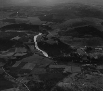 Crathie and Balmoral Castle, Balmoral Estate.  Oblique aerial photograph taken facing south-east.  This image has been produced from a print.