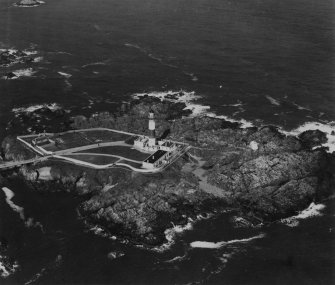 Buchan Ness Lighthouse, Boddam.  Oblique aerial photograph taken facing north-east.  This image has been produced from a print.