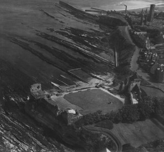 St Andrews Castle and Hind Rock.  Oblique aerial photograph taken facing south-east.  This image has been produced from a print.