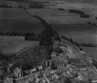 Falkland Palace and Parish Church.  Oblique aerial photograph taken facing north.  This image has been produced from a print.