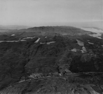 Cairnbaan and Cruach na Speireig, Knapdale.  Oblique aerial photograph taken facing south-west.  This image has been produced from a print.