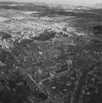 Dunfermline, general view, showing Canmore Street and Winterthur Silk Ltd. Canmore Works, Bruce Street.  Oblique aerial photograph taken facing north-west.  This image has been produced from a print.