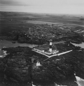 Buchan Ness Lighthouse and Boddam.  Oblique aerial photograph taken facing north-west.  This image has been produced from a print.