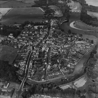 Coldstream, general view, showing High Street and Market Square.  Oblique aerial photograph taken facing north-east.  This image has been produced from a print.