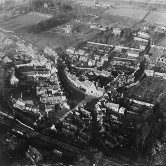 Melrose, general view, showing Market Square and High Street.  Oblique aerial photograph taken facing north.  This image has been produced from a damaged print.