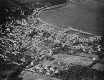 Rothesay, general view, showing Rothesay Castle and Winter Gardens, Isle of Bute.  Oblique aerial photograph taken facing north.  This image has been produced from a print.