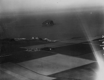 Tantallon Castle and Bass Rock.  Oblique aerial photograph taken facing north.  This image has been produced from a marked print.