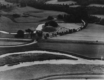 The Bass of Inverurie and Inverurie Cemetery.  Oblique aerial photograph taken facing east.  This image has been produced from a print.