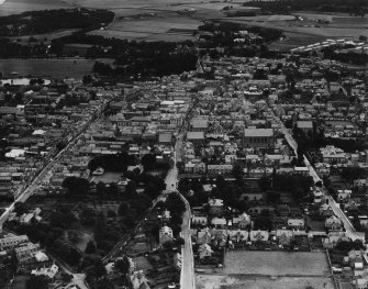Elgin, general view, showing High Street and Moray Street.  Oblique aerial photograph taken facing east.  This image has been produced from a damaged print.
