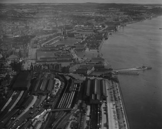 Dundee, general view, showing Dundee Docks and Tay Bridge Station.  Oblique aerial photograph taken facing north-east.  This image has been produced from a print.