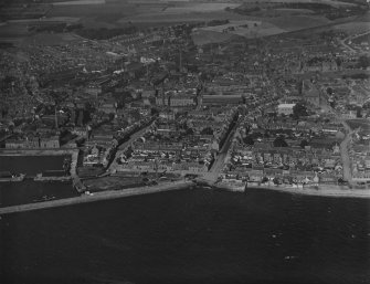 Arbroath, general view, showing High Street and Marketgate.  Oblique aerial photograph taken facing north.  This image has been produced from a print.