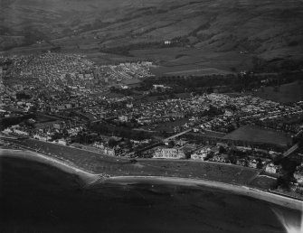 Largs, general view, showing The Broomfields and Halkshill.  Oblique aerial photograph taken facing north-east.  This image has been produced from a print.