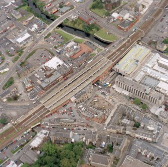 General oblique aerial view of Paisley centred on the railway station, taken from the SW.