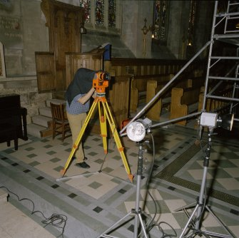 Interior. Nick Beckett (English Heritage) using photogrammetric camera to record Kennedy monument