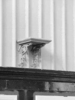 Detail of ornate bracketed shelf.