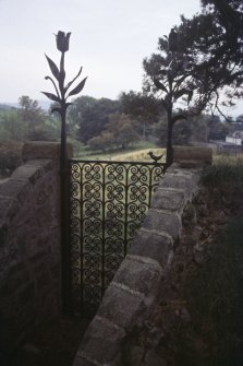 View of decorative iron gate to Churchyard, Skirling.