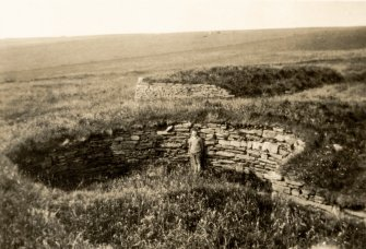 Photograph of Alaistair Sutherland standing in Nybster broch.