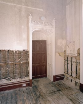 Interior. Ground floor, dining room, view of SE door and surround