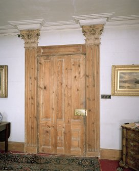 Interior. Ground floor. Hall. Detail of door with Corinthian pilasters
