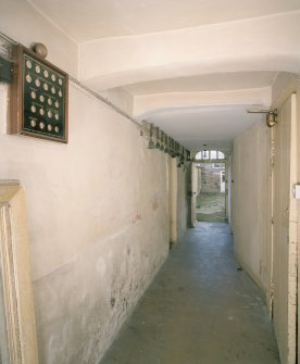 Interior. Basement. Service corridor with bell board