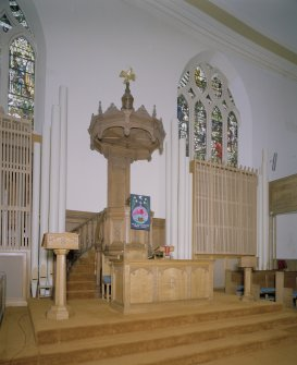 Interior. View of chancel from SW showing pulpit, font, communion table and lecturn