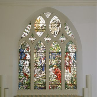 Interior. N wall W  stained glass window depicting the Good Samaritan by Christopher Whall 1896