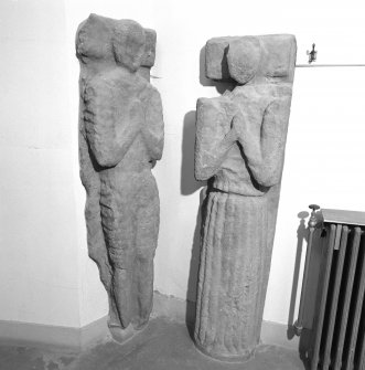 Interior. Ground floor corridor detail of sculptures of two figures