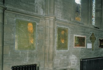 Interior. View of wall mounted brass memorial plaques, including those of Alexander Cuningham W.S., Secretary to the Commissioners of Northern Lighthouses, and his wife Caroline.