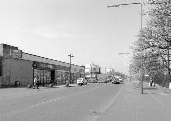 View of Niddrie Mains Rd shopping area from NE