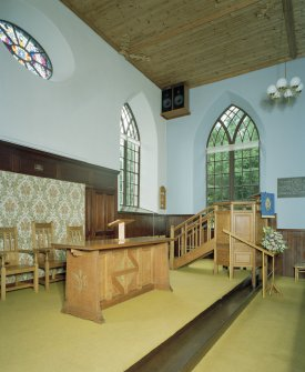 Interior, view of raised platfom from NW with communion table and pulpit