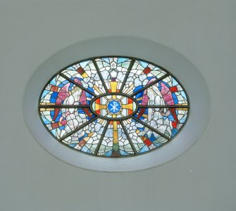 Interior. Detail of E wall oval stained glass window