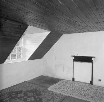 Interior. View of timber lined attic bedroom