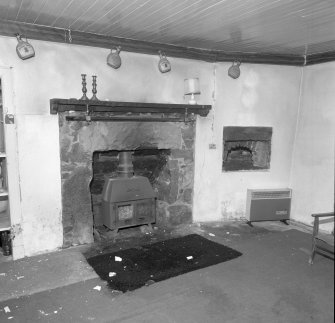 Interior. View of stone fireplace and bread oven in the South room