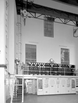 Interior. View of turbine hall and swithgear/control panels from SE, with Arrol overhead crane above