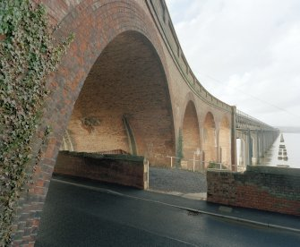 Detailed view from SSE of the curved brick viaduct forming the south end of the bridge.
