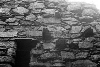 Castle Sween. Detail of window head and projecting stones on first floor of North extension.
