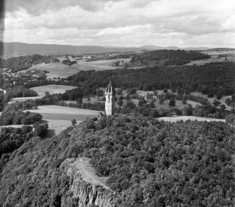 Oblique aerial view of Wallace Monument, Abbey Craig, Stirling, taken facing North.