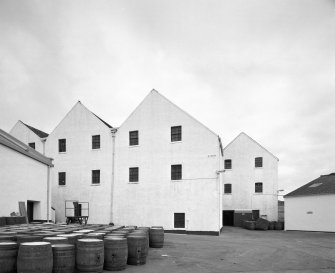 Lagavulin Distillery View from W of W side of bonded warehouses, with barrels in yard (foreground)