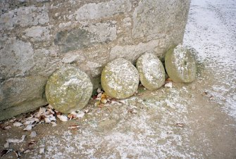 View of unprovenanced stacking stones beside church
