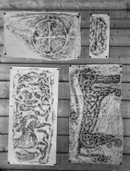 Photographic copy of four rubbings. The lower right rubbing shows central reverse panel of Rodney's Stone Pictish cross slabb, Brodie. The remaining rubbings are unidentified.