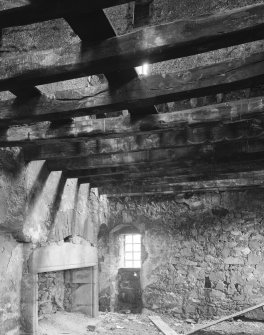 Braikie Castle. Interior. View of hall showing fireplace, painted beams and partition above.