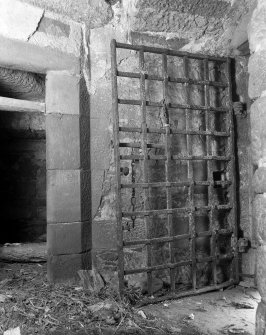 Braikie Castle. Interior. Detail of yett with alcove below main stair.