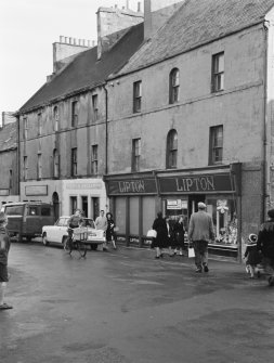 View of 1-3, 5, 7 and 9 High Street, Thurso, from south west, showing Lipton's shop.