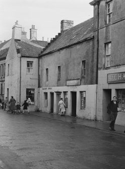 View of 9-17 High Street, Thurso, from south west showing the end of no. 9, W D Murray bicycle shop, MacKay's Stores and R Fidler shop.