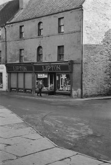 View of 1-3 High Street, Thurso, from west showing Lipton's shop.