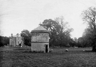 View of dovecot from WSW, with Dryburgh Abbey House in the background.