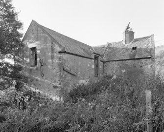 View of mill from SE, showing mill range (left) and kiln (right), also showing the water wheel on the SE gable of the mill.