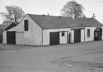 View of 1 and 3 Church Road, Kirkpatrick Durham, from north, showing Mansefield and a garage with a shell pump outside